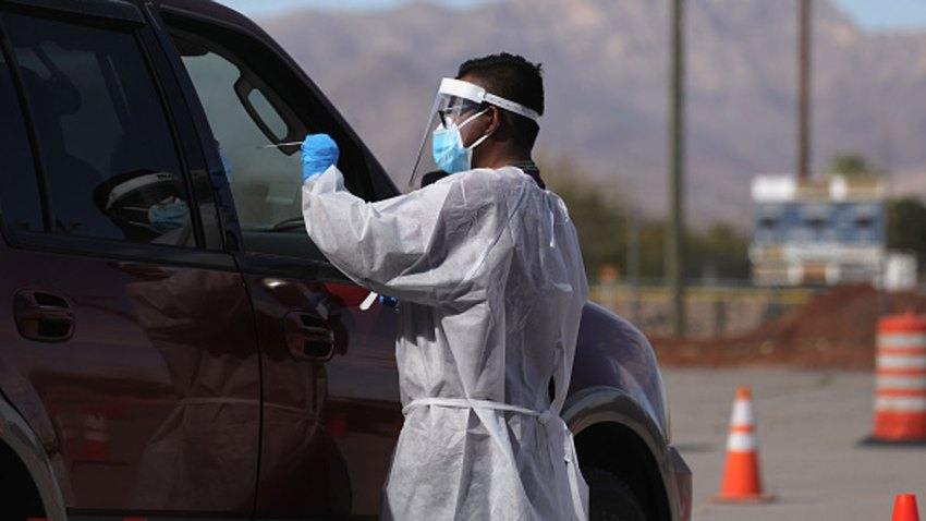 A frontline healthcare worker administers a swab test at a COVID-19 testing site amid a surge of coronavirus cases on Nov. 13, 2020 in El Paso, Texas. Texas eclipsed one million COVID-19 cases November 11th with El Paso holding the most cases statewide. Health officials in El Paso today announced 16 additional COVID-19 related deaths along with 1,488 new cases pushing the virus death toll to 741. Active cases in El Paso are now over 30,000.