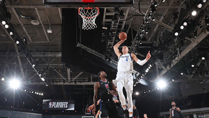 Kristaps Porzingis #6 of the Dallas Mavericks dunks the ball against the LA Clippers during Round One, Game Two of the NBA Playoffs on Aug. 19, 2020 at AdventHealth Arena in Orlando, Florida.