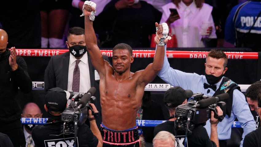 Errol Spence Jr. celebrates after defeating Danny Garcia by unanimous decision in the WBC-IBF welterweight boxing bout in Arlington, Texas, Saturday, Dec. 5, 2020. (AP Photo/Brandon Wade)