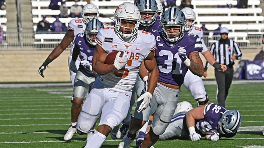 Running back Bijan Robinson #5 of the Texas Longhorns rushes for a touchdown against the Kansas State Wildcats during the first half at Bill Snyder Family Football Stadium on Dec. 5, 2020 in Manhattan, Kansas.