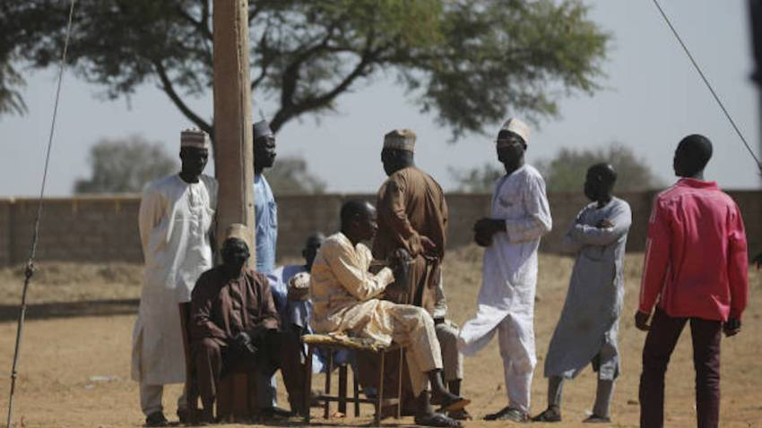 Parents wait after 300 boys were kidnapped in Nigeria.
