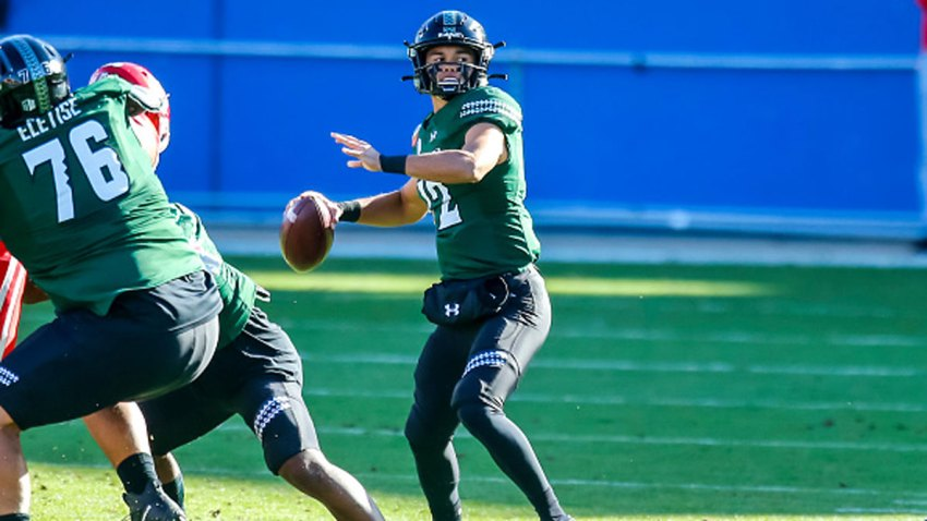 Hawaii Warriors quarterback Chevan Cordeiro (12) looks for a downfield for an open receiver during the New Mexico Bowl game between the Hawaii Warriors and the Houston Cougars on Dec. 24, 2020 at Toyota Stadium in Frisco, Texas.