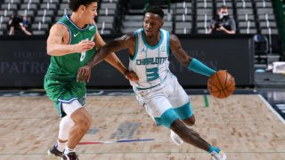 Terry Rozier #3 of the Charlotte Hornets dribbles the ball during the game against the Dallas Mavericks on December 30, 2020 at the American Airlines Center in Dallas, Texas.