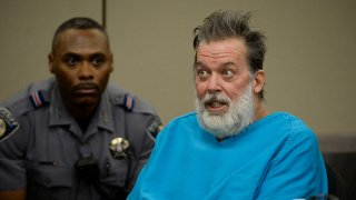 Robert Lewis Dear addresses Judge Gilbert Martinez during a court appearance December 09, 2015 in Colorado Springs, Colorado. El Paso County prosecutors filed formal charges against Lewis in the November 27 Planned Parenthood attack in which University of Colorado Colorado Springs police officer Garrett Swasey, Iraq war veteran Ke'Arre Stewart and Jennifer Markovsky, mother of two were killed.