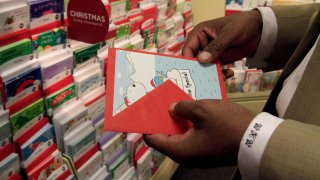 Bill Ward shops for greeting cards at the Hallmark store in Macys Plaza in Los Angeles on November