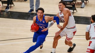 Forward Jalen Wilson #10 of the Kansas Jayhawks handles the ball against forward Marcus Santos-Silva #14 of the Texas Tech Red Raiders during the second half of the college basketball game at United Supermarkets Arena on Dec. 17, 2020 in Lubbock, Texas.
