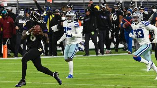 Lamar Jackson runs for a touchdown in the first quarter against the Dallas Cowboys on Tuesday, Dec. 8, 2020 at M&T Bank Stadium in Baltimore, Maryland.