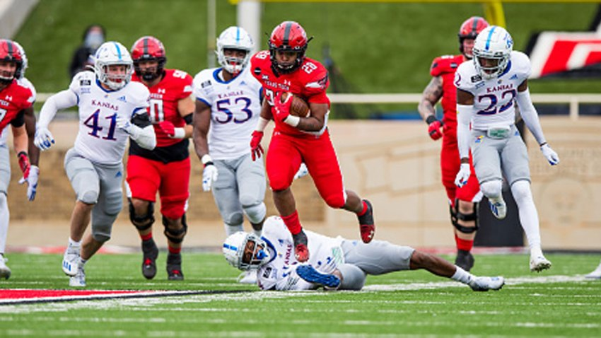 Running back Tahj Brooks #28 of the Texas Tech Red Raiders runs the ball during the second half of the college football game against the Kansas Jayhawks at Jones AT&T Stadium on Dec. 5, 2020 in Lubbock, Texas.