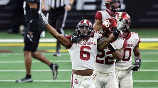 Tre Brown #6 of the Oklahoma Sooners celebrates a pass interception against the Iowa State Cyclones in the fourth quarter during the 2020 Big 12 Championship at AT&T Stadium on Dec. 19, 2020 in Arlington, Texas.