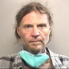 Anthony Capasso, 50, is accused of stealing a Salvation Army red kettle and threatening a security guard with a knife Monday at an Arlington Walmart, police say.