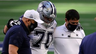 Zack Martin #70 of the Dallas Cowboys heads off the field during the first quarter of a game against the Washington Football Team at AT&T Stadium on Nov. 26, 2020 in Arlington, Texas.