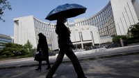 China May Be Moving Toward Easy Monetary Policy, But It Will Have to Tread Delicately