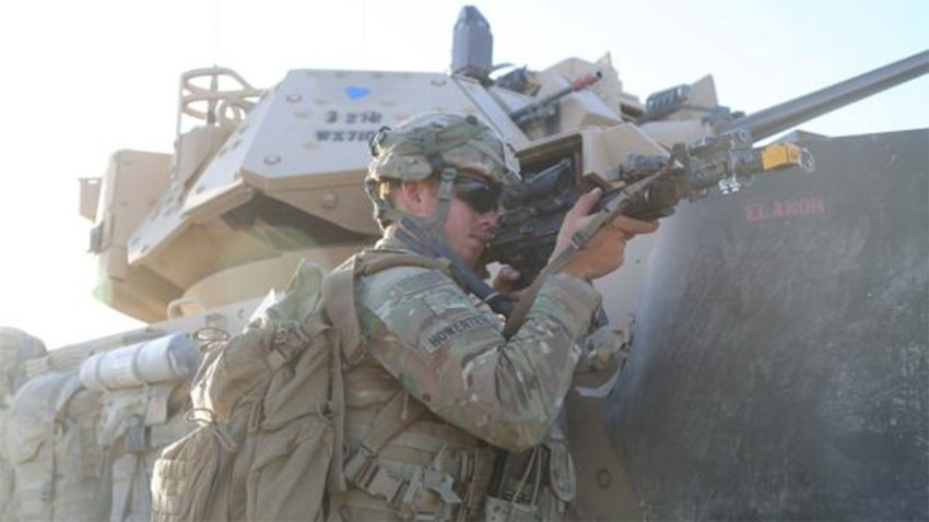 tank and soldier in the 278th Armored Cavalry Regiment