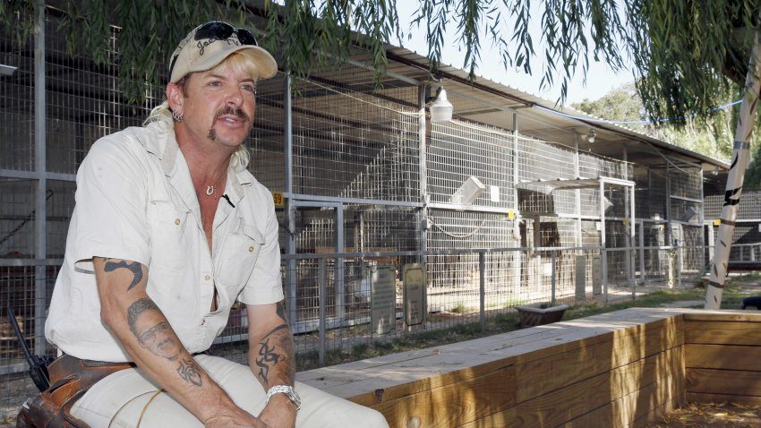 "In this Aug. 28, 2013, file photo, Joseph Maldonado answers a question during an interview at the zoo he runs in Wynnewood, Okla. Federal prosecutors on Friday, Sept. 7, 2018, announced that the zookeeper, also known as ""Joe Exotic,"" and candidate for governor earlier this year, has been charged in a murder-for-hire scheme alleging he tried to hire someone to kill a Florida woman. Prosecutors allege Maldonado-Passage tried to hire two separate people to kill the woman, who wasn't harmed. Maldonado-Passage finished third in a three-way Libertarian primary in June."