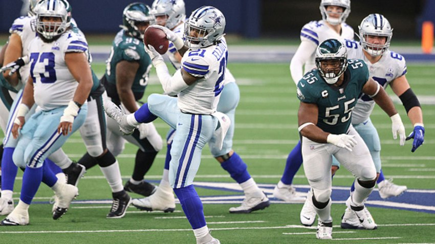 Ezekiel Elliott #21 of the Dallas Cowboys makes a catch in the first half against the Philadelphia Eagles at AT&T Stadium on Dec. 27, 2020 in Arlington, Texas.