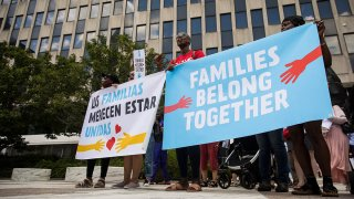 FILE - Activists, including childcare providers, parents and their children, protest against the Trump administration's family detention and separation policies for migrants along the southern border, near the New York offices of U.S. Immigration and Customs Enforcement (ICE), July 18, 2018, in New York City.
