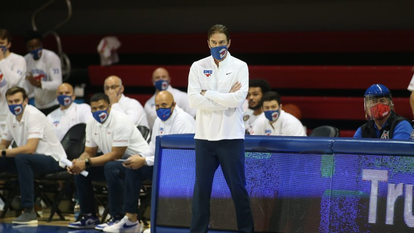 SMU Head Coach wearing a mask