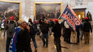 Supporters of US President Donald Trump enter the US Capitol's Rotunda on January 6, 2021, in Washington, DC