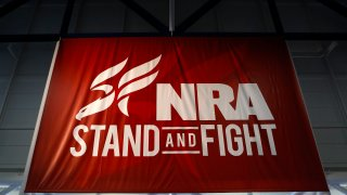 A National Rifle Association (NRA) banner is displayed during the organization's Annual Meetings & Exhibits at the George R. Brown Convention Center in Houston, Texas, U.S., on Saturday, May 4, 2013.