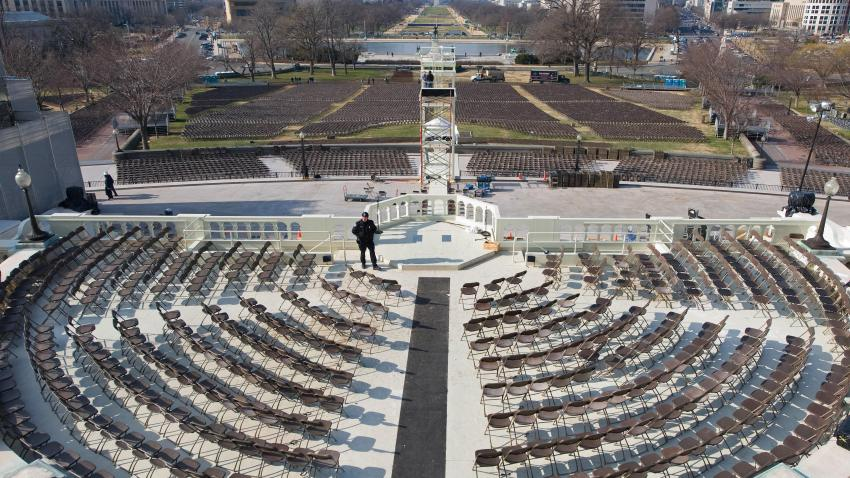 A US Capitol Police Officer keeps an eye on the VIP podium where Barack Obama will be sworn in as the 44th US President