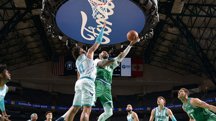 James Johnson #16 of the Dallas Mavericks shoots the ball during the game against the Charlotte Hornets on Dec. 30, 2020 at the American Airlines Center in Dallas, Texas.
