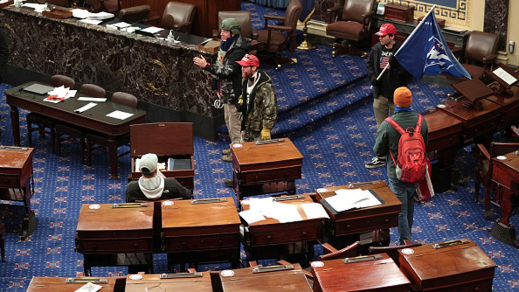 Larry Rendell Brock of Grapevine confirmed to The New Yorker Saturday that this photo shows him in the Senate Chamber on Jan. 6, 2021 in Washington, DC. Brock is pictured in combat gear in the top portion of the photo.