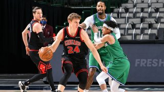 Lauri Markkanen #24 of the Chicago Bulls handles the ball during the game against the Dallas Mavericks on Jan. 17, 2021 at the American Airlines Center in Dallas, Texas.