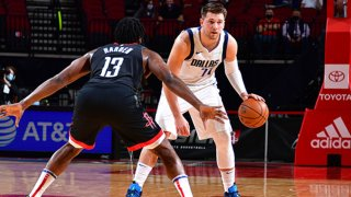 Luka Doncic #77 of the Dallas Mavericks handles the ball against James Harden #13 of the Houston Rockets during the game on Jan. 4, 2021 at the Toyota Center in Houston, Texas.