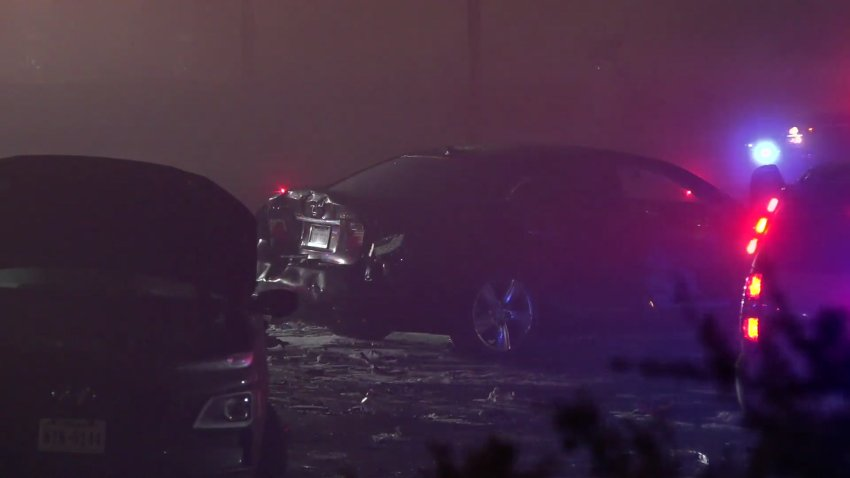 A 39-year-old woman is in custody following a crash that left a man dead and three other people hospitalized, police say.