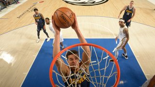 Michael Porter Jr. #1 of the Denver Nuggets dunks the ball during the game against the Dallas Mavericks on Jan. 25, 2021 at the American Airlines Center in Dallas, Texas.