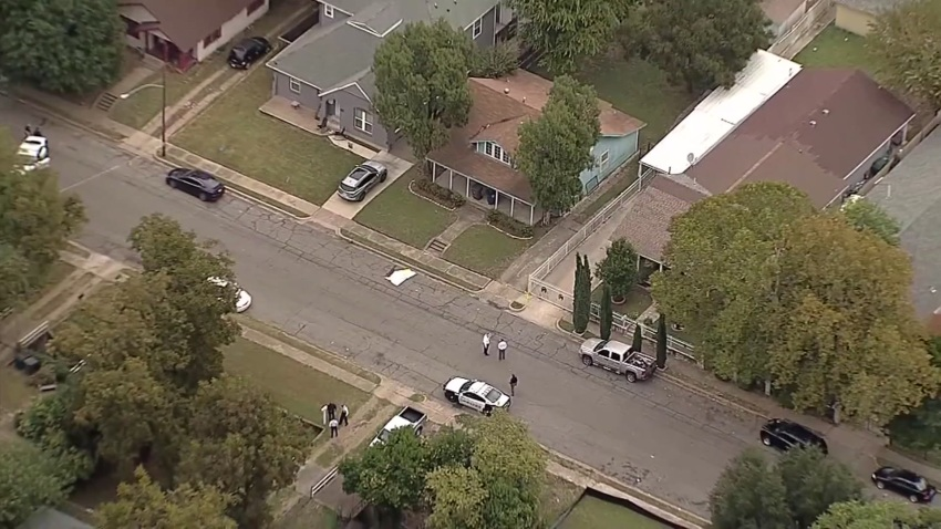 Dallas police investigate the location where James Faith was shot and called on Waverly Drive on Oct. 9, 2020.