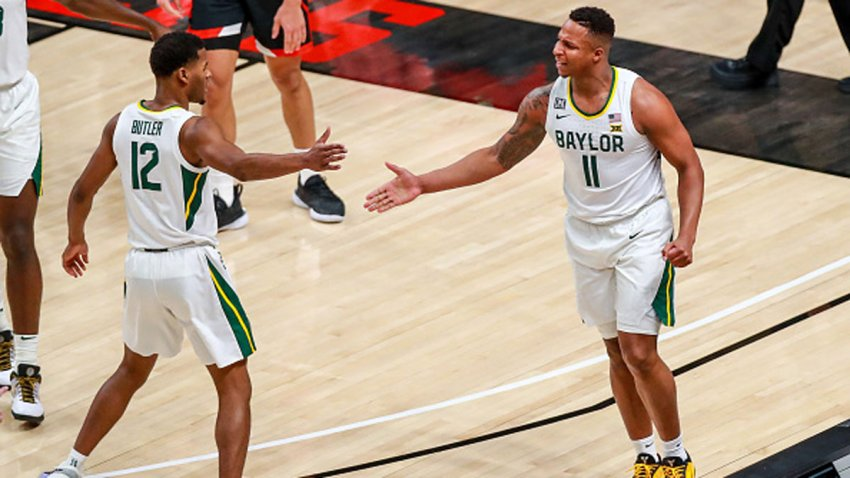 Guards Mark Vital #11 and Jared Butler #12 of the Baylor Bears high five during the first half of the college basketball game against the Texas Tech Red Raiders at United Supermarkets Arena on Jan. 16, 2021 in Lubbock, Texas.