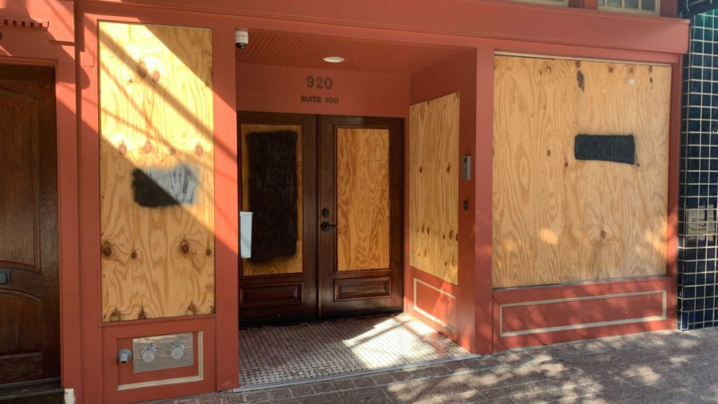 A storefront is boarded up near the Texas Capitol, which closed through Wednesday due to threat of armed protests, in Austin, Texas on Saturday, Jan. 16, 2021.