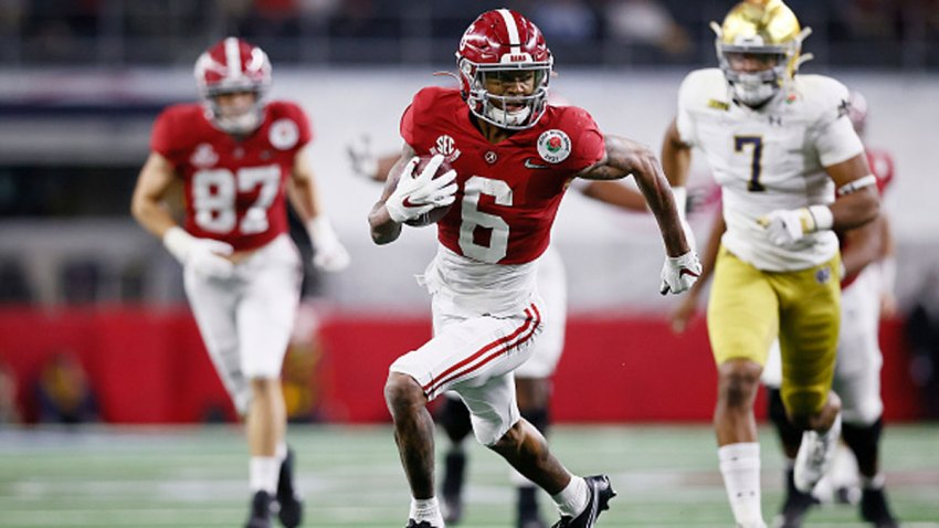 Wide receiver DeVonta Smith #6 of the Alabama Crimson Tide rushes for a touchdown over the defense of Notre Dame Fighting Irish during the second quarter of the 2021 College Football Playoff Semifinal Game at the Rose Bowl Game presented by Capital One at AT&T Stadium on Jan. 1, 2021 in Arlington, Texas.