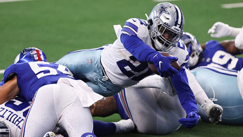 Ezekiel Elliott #21 of the Dallas Cowboys dives for a touchdown against the New York Giants during the second quarter at AT&T Stadium on Oct. 11, 2020 in Arlington, Texas.