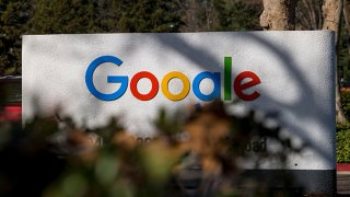 Signage at an entrance to a building on the Google campus in Mountain View, California, U.S., on Wednesday, Dec. 16, 2020. On Wednesday, Texas Attorney GeneralKen Paxtonfiled anantitrust lawsuitagainstAlphabet Inc.'s Google. At its center is a bold claim: Google colluded with archrivalFacebook Inc.in an illegal deal to manipulate auctions for online advertising, an industry the two companies dominate.