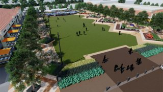 Design of Hillcrest Village park. It has a large green area with trees stretching down the length of the green field. Behind the trees are restaurants. On onw wide side of the design is a play area for children. The other wide side contains small plants.