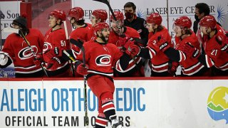 Vincent Trocheck #16 of the Carolina Hurricanes celebrates his shootout goal with teammates on the bench during an NHL game against the Dallas Stars on Jan. 31, 2021 at PNC Arena in Raleigh, North Carolina.