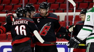 Vincent Trocheck #16 of the Carolina Hurricanes scores a goal and celebrates with teammates during an NHL game against the Dallas Stars on Jan. 30, 2021 at PNC Arena in Raleigh, North Carolina.