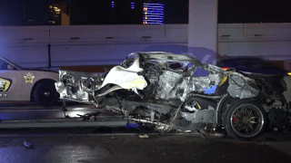 One person died Sunday morning when their Infiniti struck an attenuator at the Interstate 35 split with Interstate 30 near downtown Dallas and caught fire, according to the Dallas County Sheriff's Department.