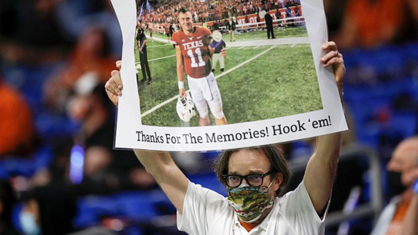 A Texas Longhorns fan holds a sign for Sam Ehlinger #11 during the Valero Alamo Bowl against the Colorado Buffaloes at the Alamodome on Dec. 29, 2020 in San Antonio, Texas.