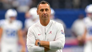 Alabama assistant coach Steve Sarkisian watches the offense warm up prior to the start of the Chick-fil-A Kickoff football game between the Duke Blue Devils and the Alabama Crimson Tide on Aug. 31, 2019 at Mercedes-Benz Stadium in Atlanta, Georgia.