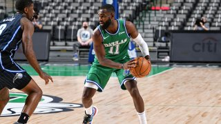 Tim Hardaway Jr. #11 of the Dallas Mavericks looks to pass the ball during the game against the Orlando Magic on Jan. 9, 2021 at the American Airlines Center in Dallas, Texas.