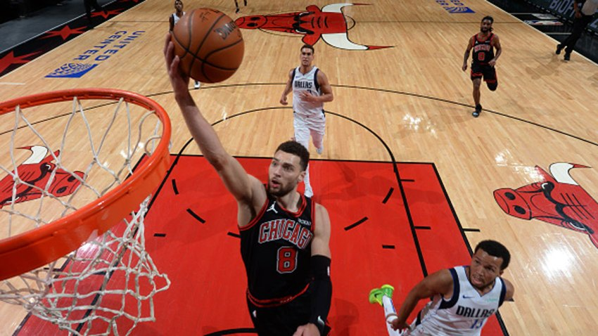 Zach LaVine #8 of the Chicago Bulls dunks the ball on Jan. 3, 2021 at the United Center in Chicago, Illinois.