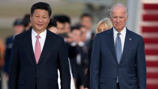 Chinese President Xi Jinping and Vice President Joe Biden walk down the red carpet on the tarmac during an arrival ceremony in Andrews Air Force Base, Md., Thursday, Sept. 24, 2015. Chinese President Xi Jinping and his wife Peng Liyuan are traveling to Washington for a State Visit.