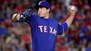 Derek Holland #45 of the Texas Rangers pitches against the Tampa Bay Rays in the top of the eighth inning at Globe Life Park in Arlington on Oct. 1, 2016 in Arlington, Texas.