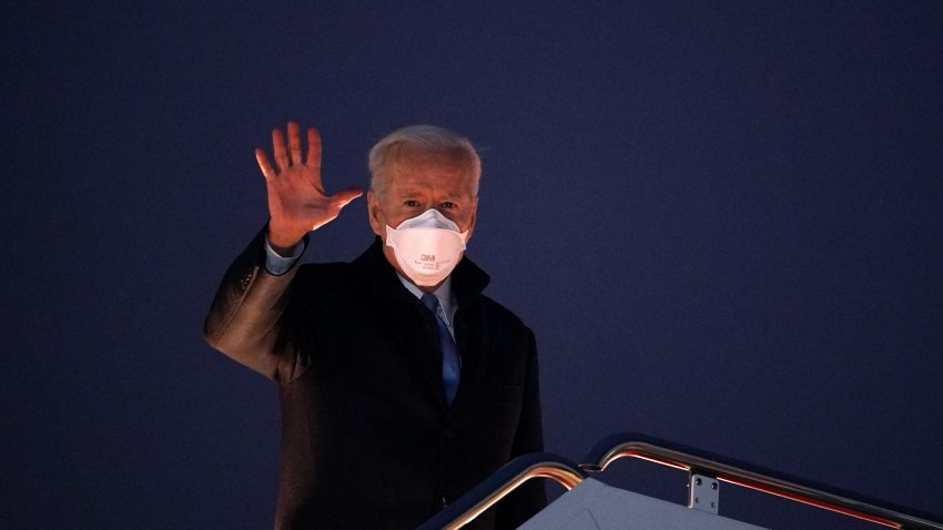 US President Joe Biden waves as he boards Air Force One before departing from Andrews Air Force Base in Maryland on February 12, 2021.