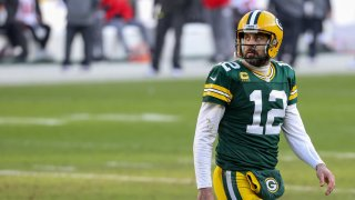 Aaron Rodgers #12 of the Green Bay Packers walks across the field in the second quarter against the Tampa Bay Buccaneers during the NFC Championship game at Lambeau Field on January 24, 2021 in Green Bay, Wisconsin.