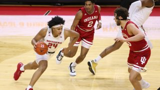 Ron Harper Jr. of Rutgers drives against Armaan Franklin and Race Thompson of Indiana during a game at Rutgers Athletic Center on Feb. 24, 2021, in Piscataway, New Jersey.