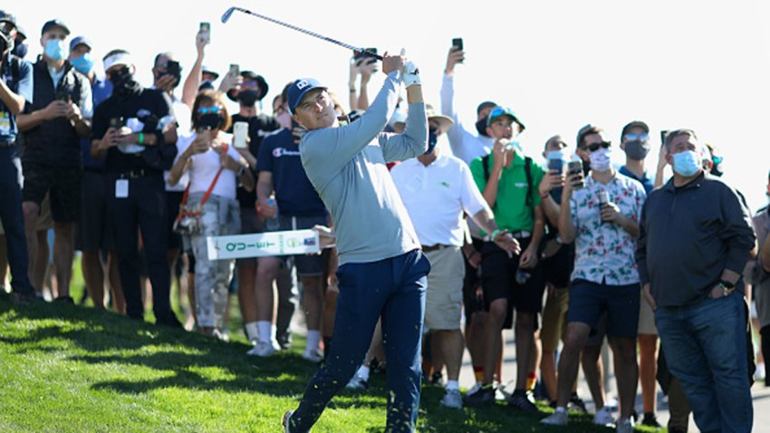 Jordan Spieth of the United States hits his approach shot on the 18th hole during the third round of the Waste Management Phoenix Open at TPC Scottsdale on Feb. 6, 2021 in Scottsdale, Arizona.